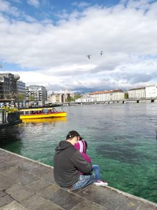 Photo showing the author and his daughter sitting close to the lake in Geneva.